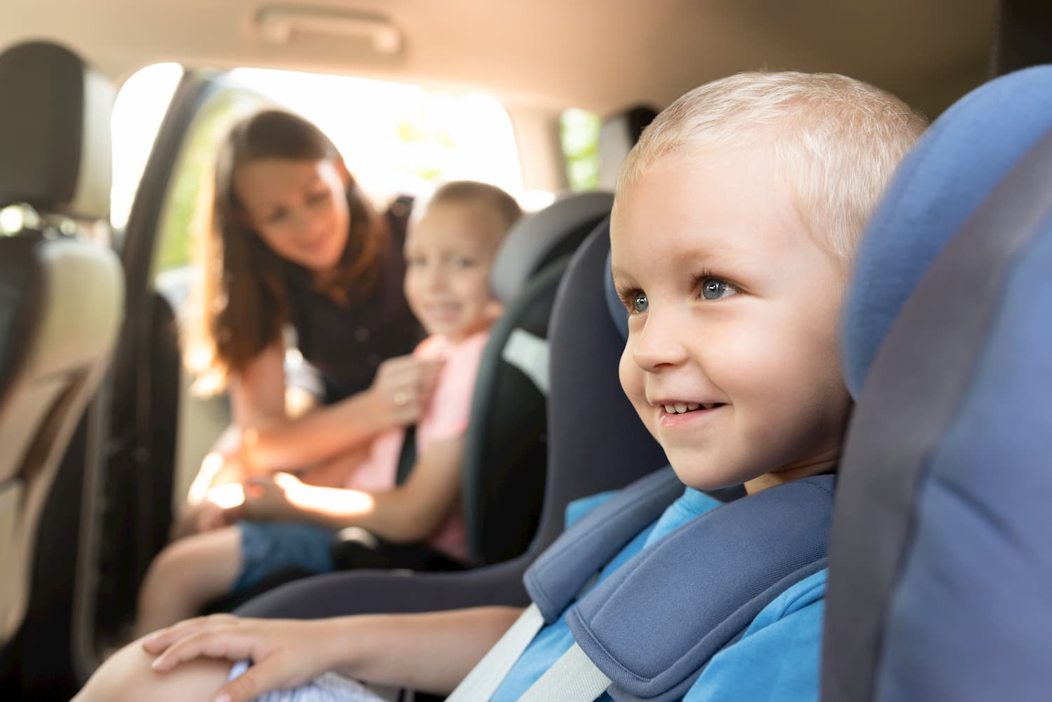 Childrens sitting in convertible car seat