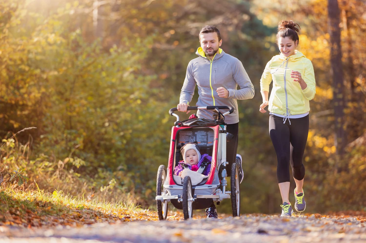 Young family running with jogging stroller